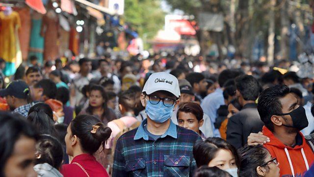 Man wearing face mask in crowd