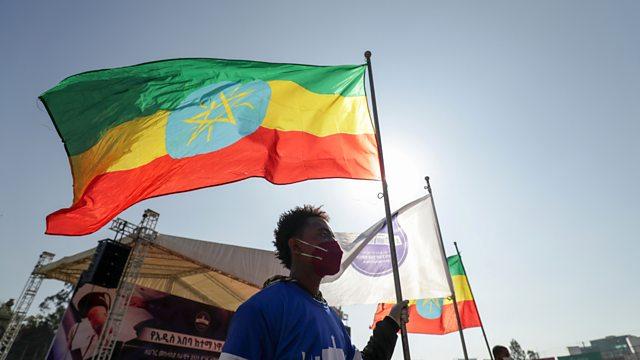 Man holding Ethiopian flag