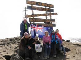 Photograph of people at summit of Mt Kilimanjaro