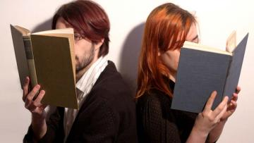 Photo of two people reading books